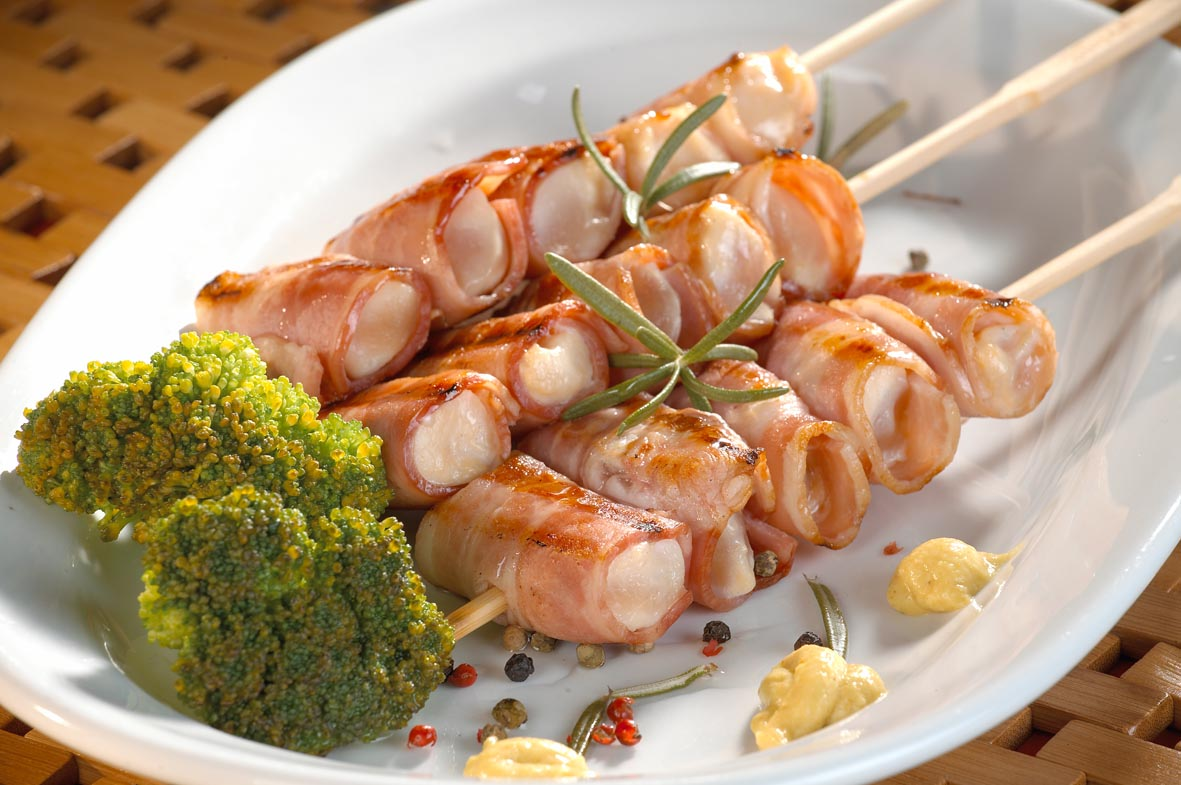 Skewered chicken rolls in bacon