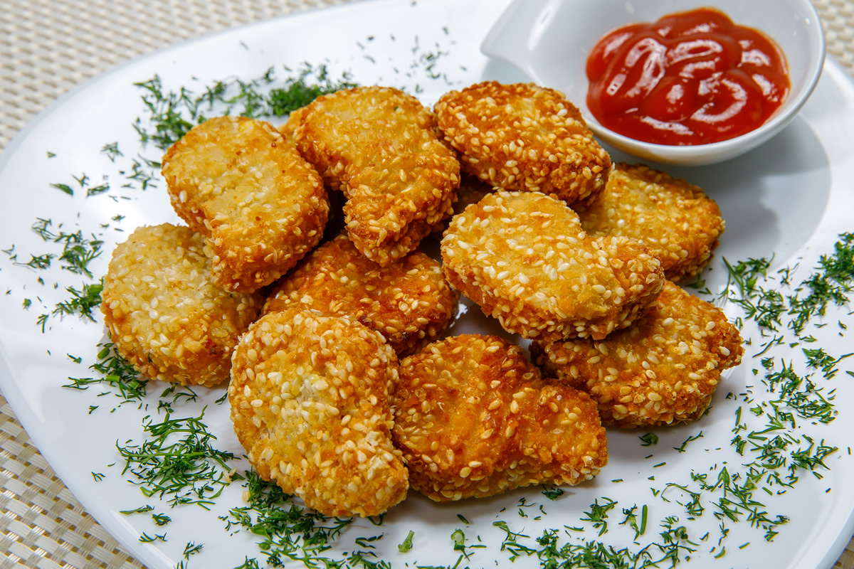 Chicken nuggets with sesame breading